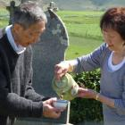 Leslie and Maisie Wong, of Dunedin, perform a Chinese spiritual blessing and prayer at Drybread...
