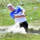 Alastair Hinsley swings out of a bunker at the Chisholm Links earlier this week. PHOTO: PETER...