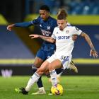 Arsenal's Joe Willock (left) and Leeds United's Jack Harrison battle for the ball during the...