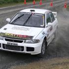 Andrew Graves, of Gore, punts his Mitsubishi EVO 3 around the tight Cairns Rd-Roberts Rd...