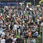 About 6000 people surged through the gates and covered the turf at Forsyth Barr Stadium yesterday...