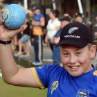 Shilo Hogg (11) is introduced to bowls at the Taieri Bowling Club's bowls3five tournament. PHOTO...