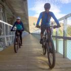 Brenda Lucius (left) and Geert Linders explore a section of the Dunstan Trail near Bannockburn...