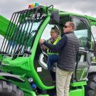Anama arable farmer Sonya Spencer receives telehandler instruction from Power Farming owner Simon...