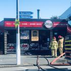 Fire crews were called to Pizza Bella in Mosgiel after a fire broke out in the kitchen. Photo:...