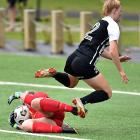 Southern United goalie Tessa Nicol gets to the ball first despite the best effort of Northern...