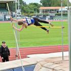 Taieri athlete Gabi Horo (16) nudges the bar during the pole vault at an Athletics Otago meeting...