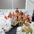 A group of volunteers at Kaiapoi Community Support with some of the food donated during last year...