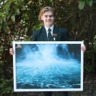 Aparima College pupil Dom Riddell displays one of the photographs he took at Milford Sound. PHOTO...