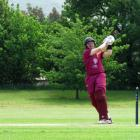 North East Valley batsman Llew Johnson swats a another deliver in the direction of the boundary...