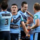 Nathan Cleary celebrates with his New South Wales team mates following the team's victory in...