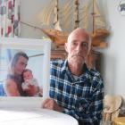 Bruce Cawley holds a photo of his stepson, Craig Andrew, who was flown to Dunedin Hospital in a...