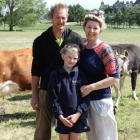 Glen, Bron and Amelia (9) Claridge are loving the new challenge as owners of The Natural Dairy....