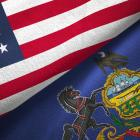 Pennsylvania state and United States flags. Photo: Getty Images