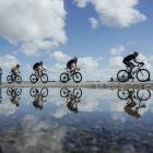Corbin Strong, of PowerNet, (fourth from right) defends the yellow jersey during stage five of...