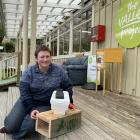 Open Valley Urban Ecosanctuary community engagement co-ordinator Clare Cross shows a couple of...