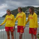 Watching the surf at St Clair beach are (from left) lifeguard Imogen Doyle, Surf Life Saving New...