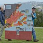 Marco Brenna (left) and Mike Palin, of the University of Otago geology department, with a map...