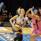 Otago Gold Rush forward Zoe Richards takes the ball to the hoop as Zarya Poulava, of the Waikato...
