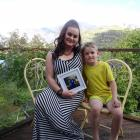 Queenstown resident Peggy Hieronymus clutches a picture of her stranded daugther, Xavion, 11,...