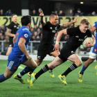 Arron Smith celebrates as Damian McKenzie scores a try against France in Dunedin in 2018. Photo:...