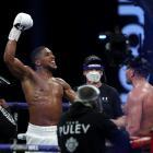 Anthony Joshua celebrates winning his fight against Kubrat Pulev in London on Saturday. Photo:...