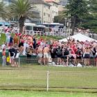 People gather at Bronte Beach in Sydney on Christmas Day, in this still image taken from social...