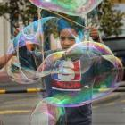 Making big soap bubbles is Jonathan Luavasa (11).