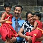 Santhosh Kunnumpurath Jose (37, left) and Merlin Mathew (35), of India, celebrate joining their...