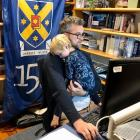 University of Otago chief operating officer Stephen Willis works from home with his son, Alby (2)...