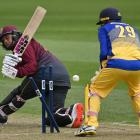 Otago wicketkeeper Mitch Renwick watches as Northern Districts opener Katene Clarke is bowled by...