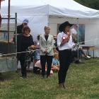 Christchurch Mayor Lianne Dalziel watches while show president Tania Kiely addresses the crowd,...