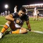 Elijah Taylor looks dejected after conceding a try in 2017 while playing for the Tigers. Photo:...