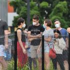 People queue to have a Covid-19 test at Royal North Shore hospital in Sydney. Photo: Getty