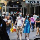 Christmas Eve shoppers wear face masks in the Sydney CBD. Photo: Getty
