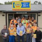 Harraways staff in front of the company's head office in Green Island this week. Chief executive...