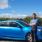 Jesse Miller with his Mazda Axela car in Lumsden, during his holiday road trip to Dunedin. PHOTO:...
