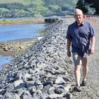 University of Otago coastal geographer Associate Prof Mike Hilton walks along a section of Otago...