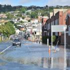 Flooding on St Andrew St in Dunedin on Saturday morning. Photo: Christine O'Connor