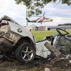 The Northland Rescue Helicopter lifts off from the freezing works grounds with the wrecked car in...