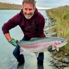 Dunedin fisherman Peter Scott with the 10kg rainbow trout he caught in the canals ...