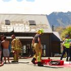 A firefighter speaks to the occupants of a house in Goldfield Heights, Queenstown, damaged in a...