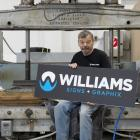 Dunedin man Alan Rohtmets (70) sits on an old hydraulic press which he recalls arriving at...