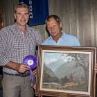 PGG Wrightson's national velvet manager Tony Cochrane (left) presents Greg Oliver, of Palmerston,...
