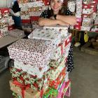 Dunedin community leader Ana Mapusua is pictured in her garage with some of the 300 Christmas...