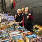 Volunteers at the Regent Theatre's ''Good As New'' book and gift sale, (from left) Christine...
