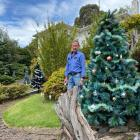 Green Island man Murray Moore in the front yard of his District Rd home, which is decorated with...
