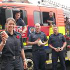 Christmas food and can drive co-ordinator and senior firefighter Aimee Taylor and (from left,...