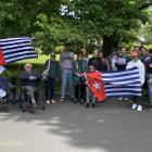 Members of the West Papua Support Dunedin group and supporters fly the Morning Star flag at the...