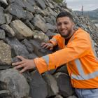 Mohamad Alashour shows off the new stone sea wall in Broad Bay, on Otago Peninsula, which he...